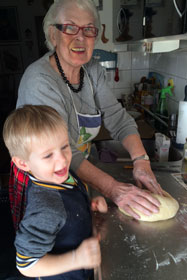Karin baking with her great grandson