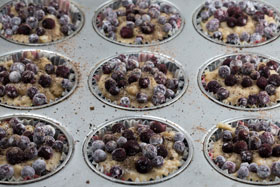 Cardamom muffins with bilberries and lime before being baked