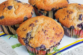 Cardamom muffins with bilberries and lime on a plate