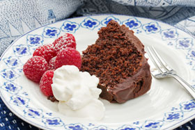 Chocolate sponge cake with whipped cream and raspberries