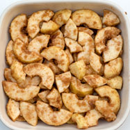 Apples tossed in sugar, cinnamon and breadcrumbs to make a Swedish äppelkaka
