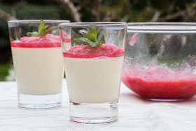Vanilla panna cottas in glasses topped with rhubarb compote
