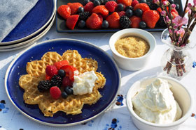 Swedish heart-shaped waffles served with fresh fruit and whipped cream