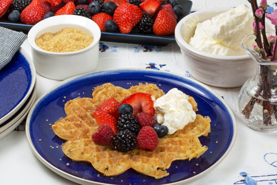 Swedish waffles served with berries and whipped cream