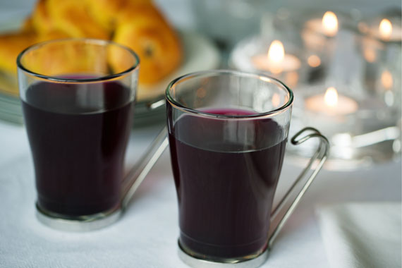 Two glasses of warm blueberry cordial