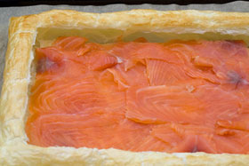 A puff pastry case filled with smoked salmon