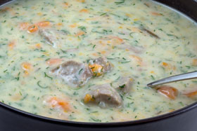 Lamb with a creamy dill sauce in a saucepan