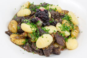 Venison stew with bilberry sauce and gnocchi