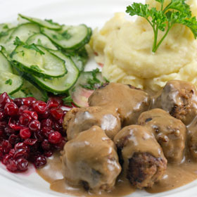 Swedish meatballs with pressed cucumber, stirred lingonberries and mashed potato