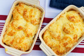 Two dishes of potato and celeriac gratin
