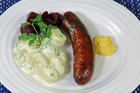 Potatoes in chive sauce with pickled beetroot and a smoked Swedish sausage