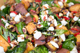 Sweet potato salad with grains, feta cheese and chilli