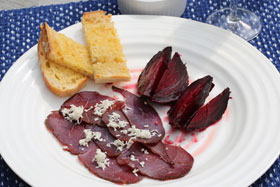 Salt baked beetroot with venison, grated horseradish and toast