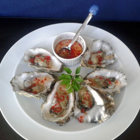 Oyster with a chilli and dill dip