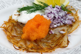 Swedish potato pancakes with roe, red onion and crème fraîche