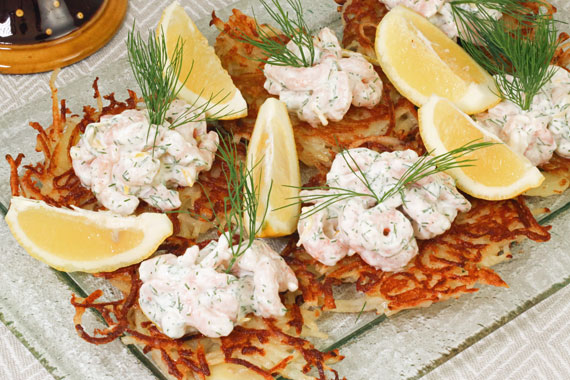 Pot pancakes topped with prawns in a creamy dill sauce
