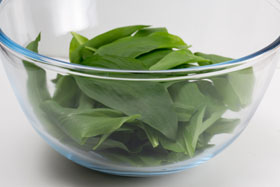 50 g grams of wild garlic leaves in a bowl
