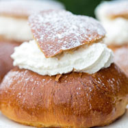 Semlor, soft cardamom buns filled with almond paste and whipped cream