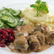 Swedish meatballs with cream sauce, lingonberries and pressed cucumber