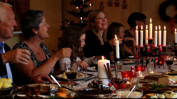 A dinner scene from the Advent ap