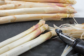 White asparagus being peeled
