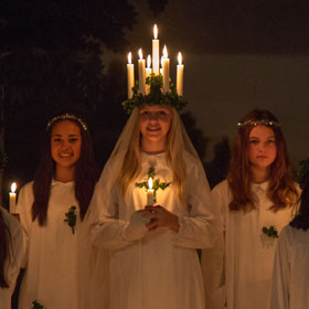 Lucia with candles at a concert in Skansen, Stockholm
