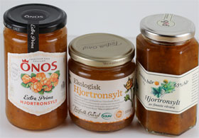 Three jars of commercially produced cloudberry jam